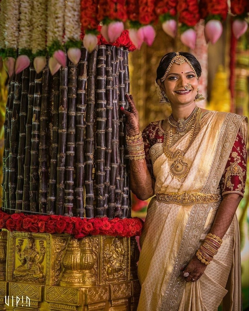 Gold and tussar color south Indian wedding saree.