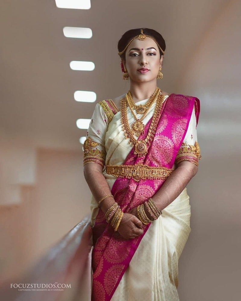 Crème and Pink south Indian wedding saree.