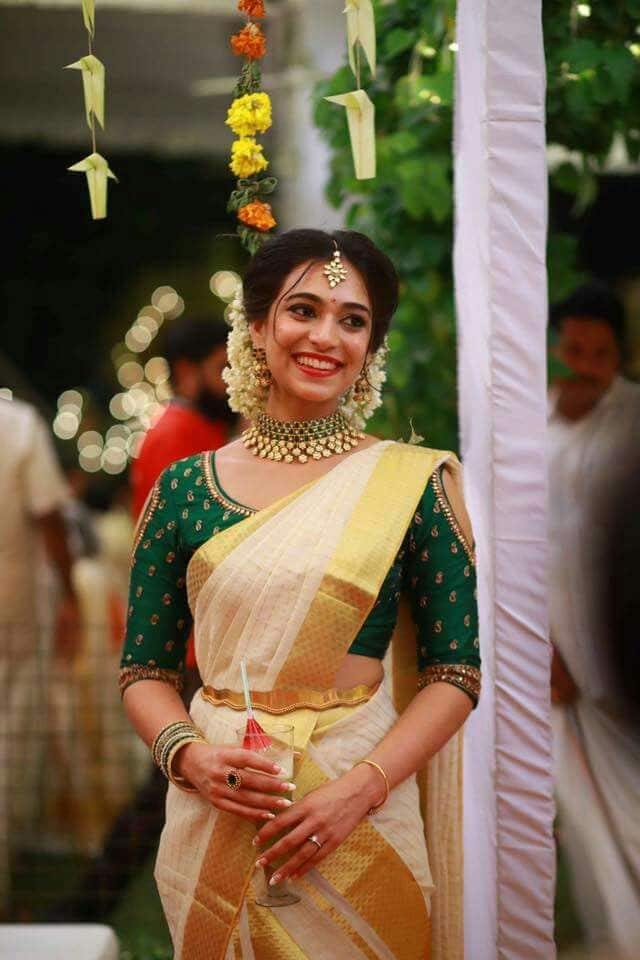Green Blouse with The Kasavu Saree