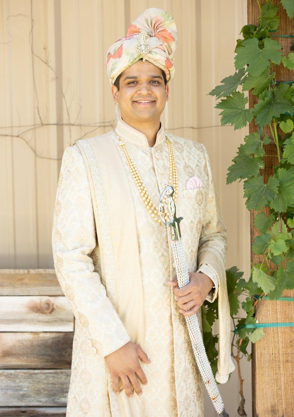 Indian groom wearing printed pagadi